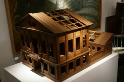 An architectual model of Roman inspired villa with stables.