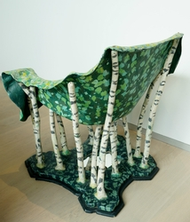 This a mixed media chair, with a mirror as a lake.